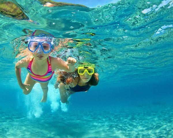 children-snorekling-in-blue-lagoon-near-split