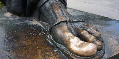golden toe of Gregory Nin statue in Split