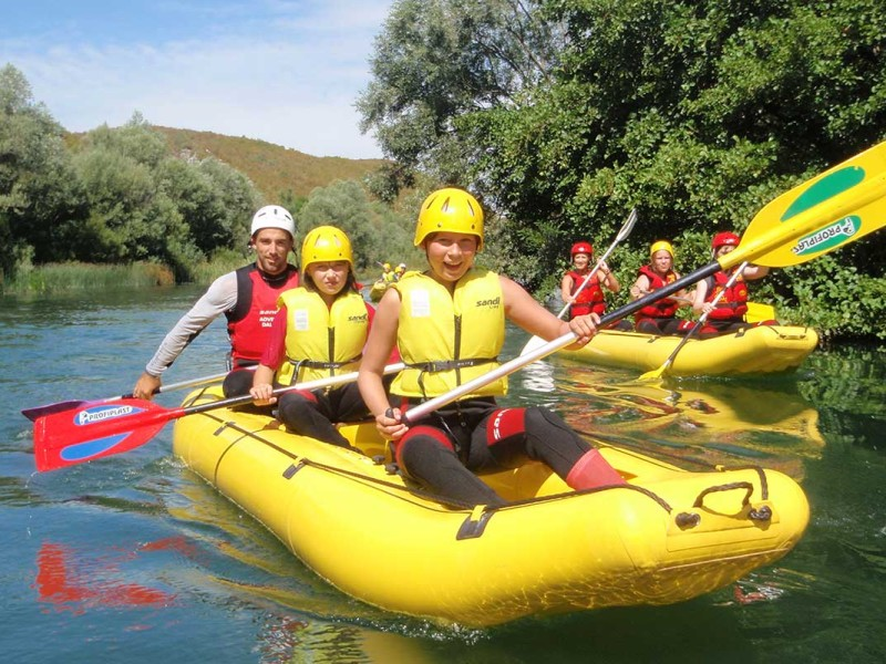 Kids learning how to steer on Cetina river rafting tour