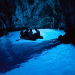inside-the-blue-cave-in-a-dinghy