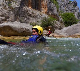 Sliding into the river rapid on Cetina canyoning tour from Split