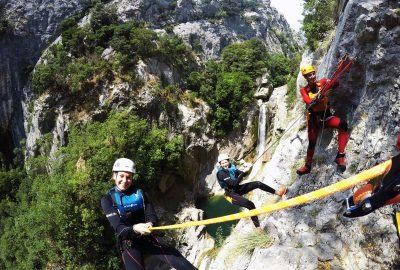 Group abseiling by waterfall in Cetina canyon
