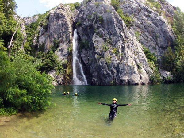 Relaxing in Cetina lake by the waterfall