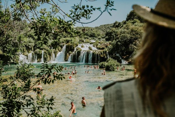 watching people swimming by Krka waterfalls