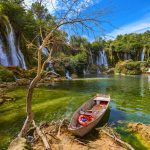 lake boat by Kravice waterfalls